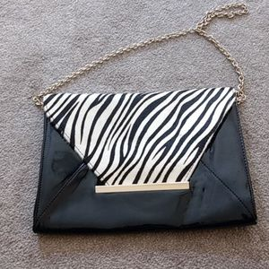 Zebra and black clutch.
